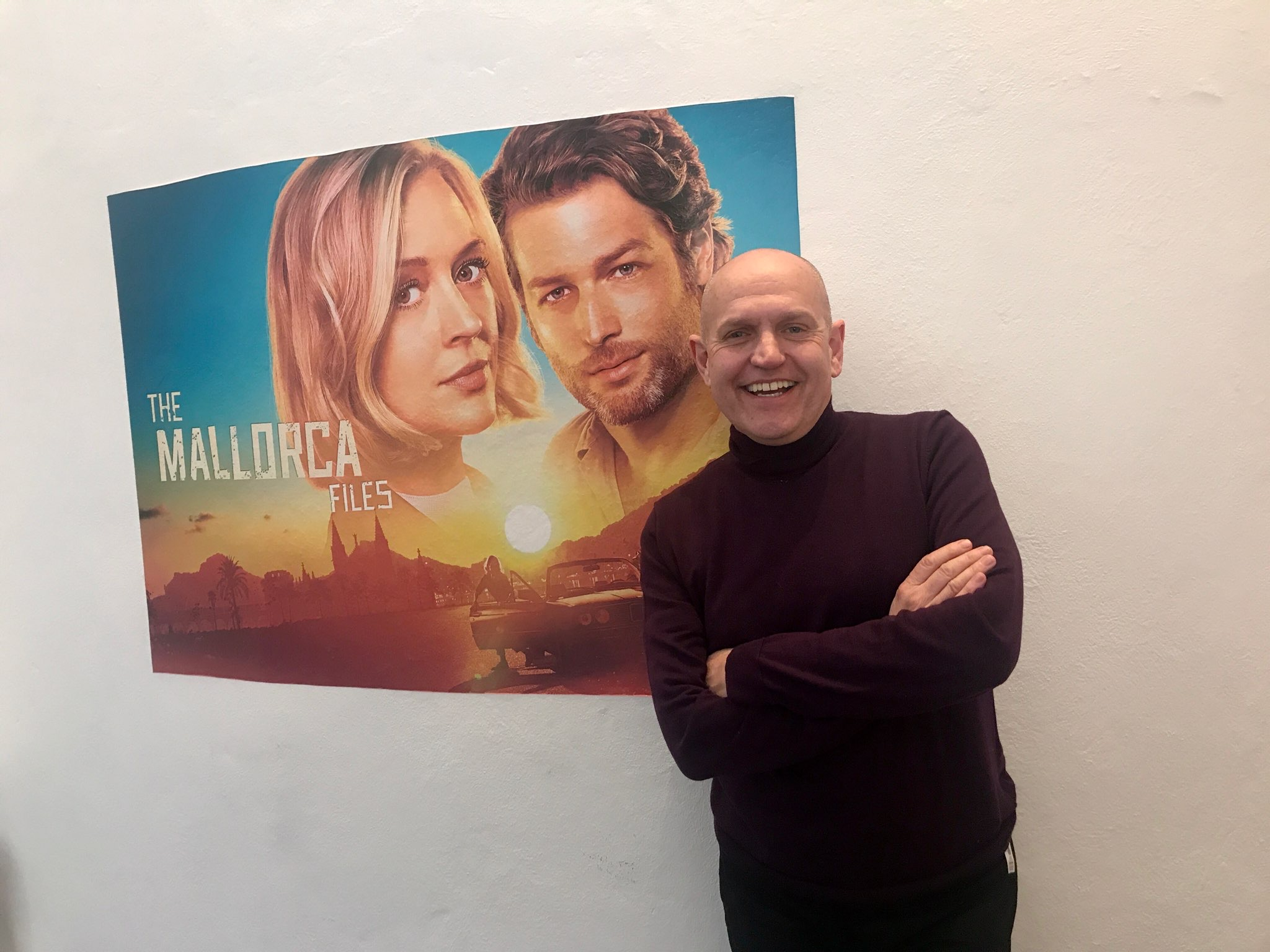 man in front of poster