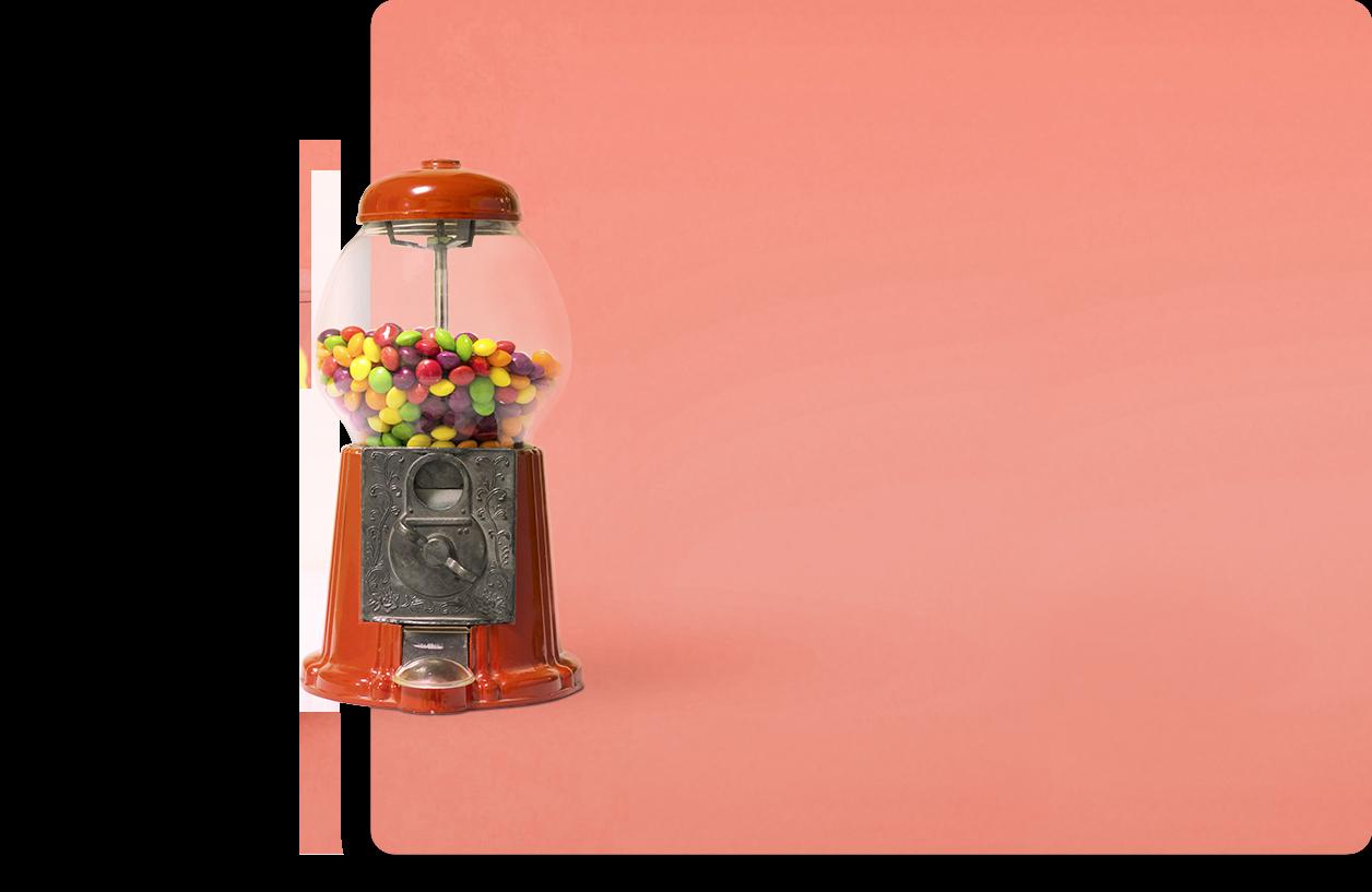 Photo d'un distributeur à bonbon sur fond corail