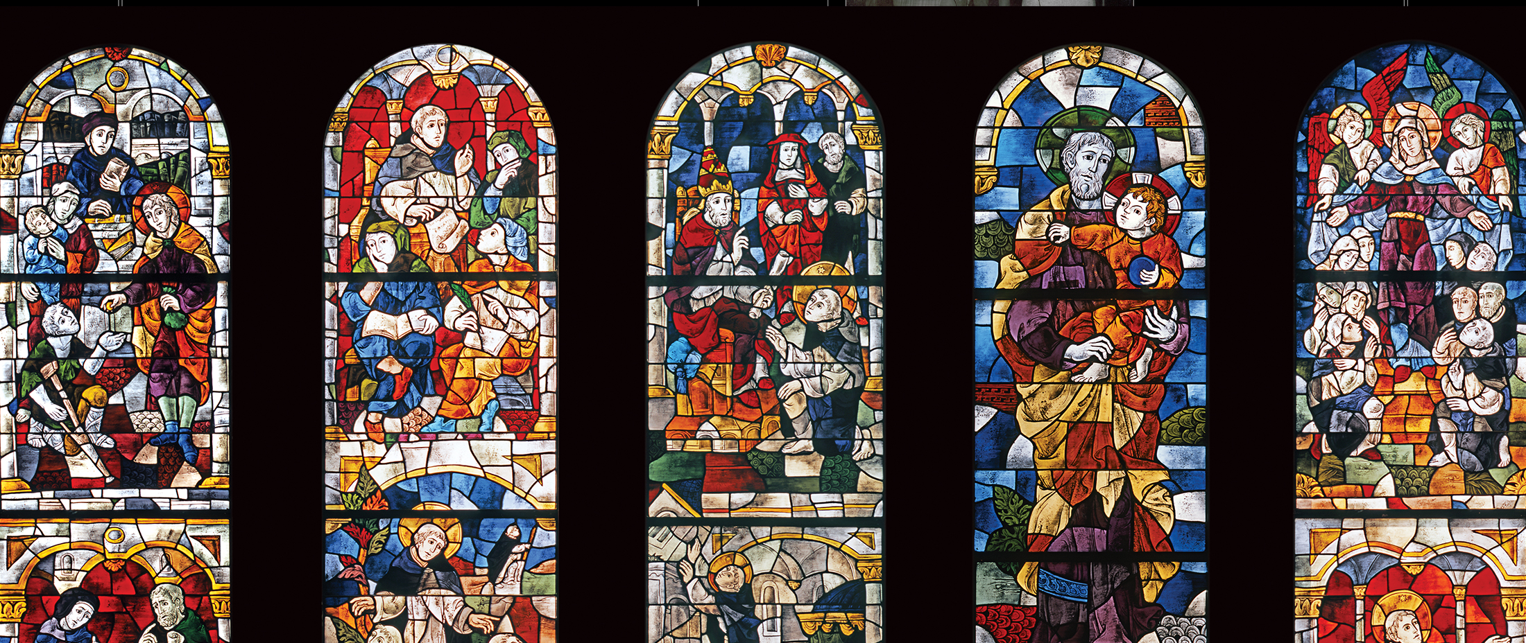 Interior spread: Stained glass depicting Dominican Order | Robertson Design