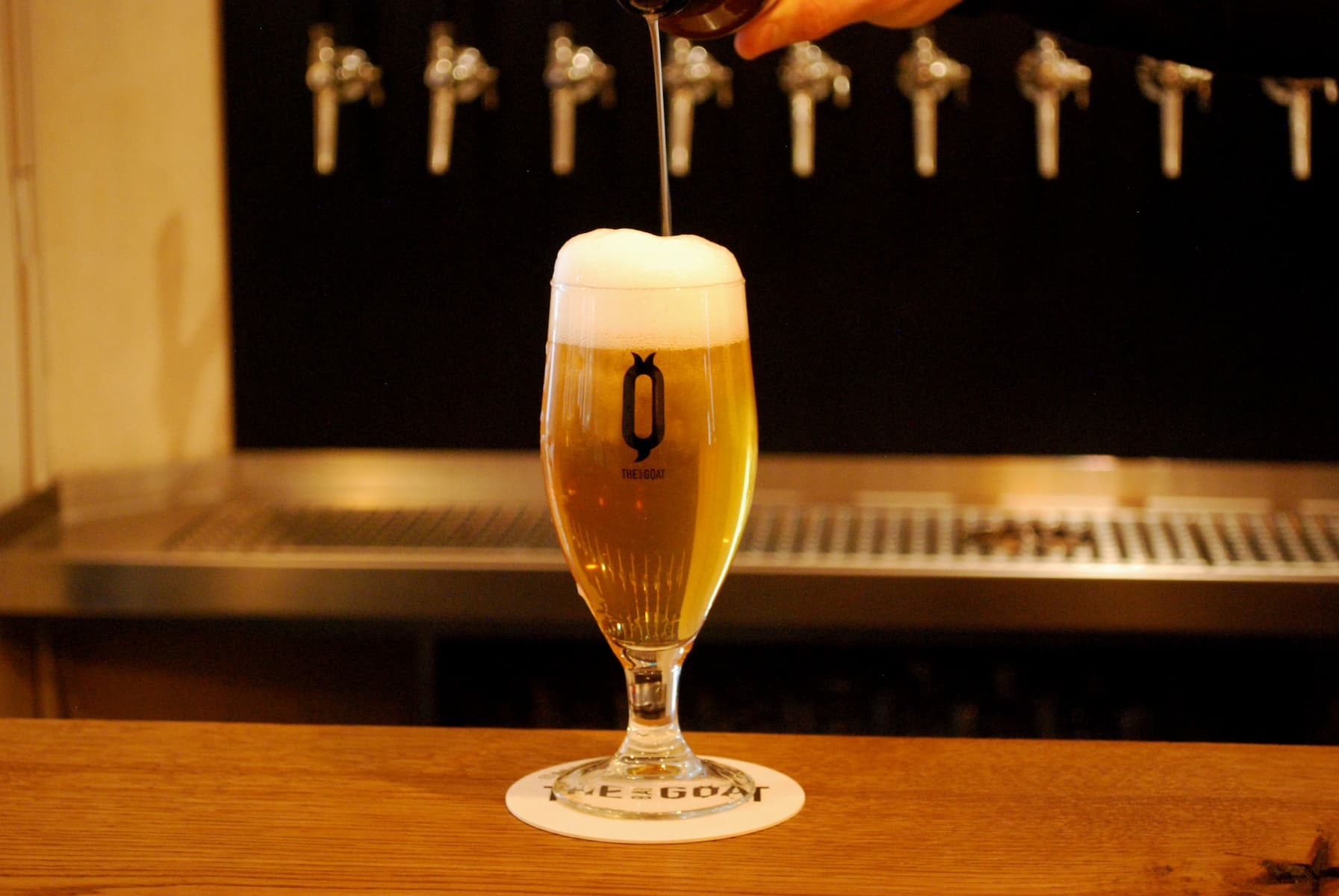 A fresgly tapped beer on our custom-made bar surface.