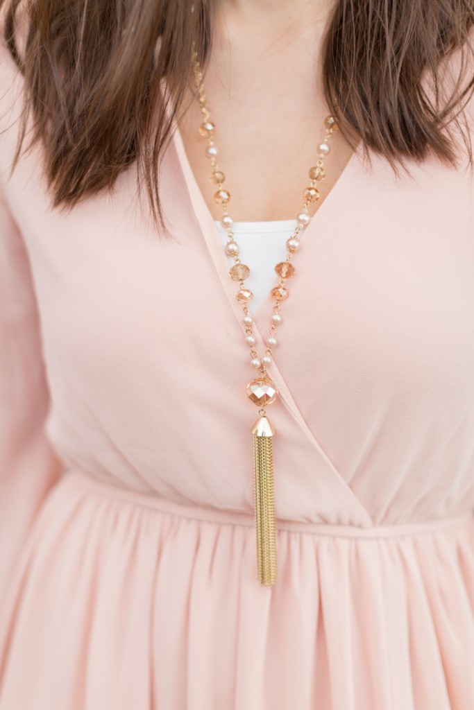 Pink engagement dress with gold accessories and necklace