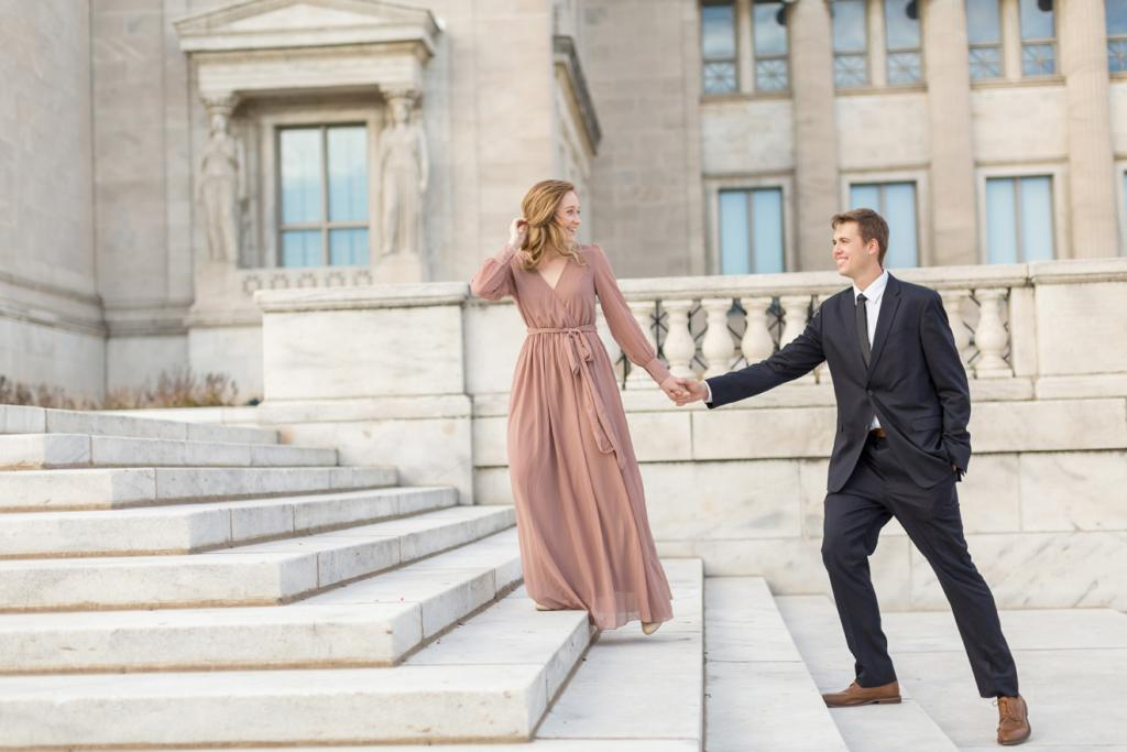 Engagement session pink dress and black suit on modern marble stairs