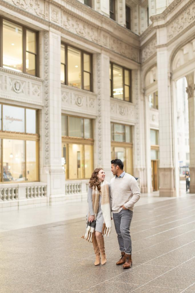 Modern couple engagement photo at the Wrigley building Chicago
