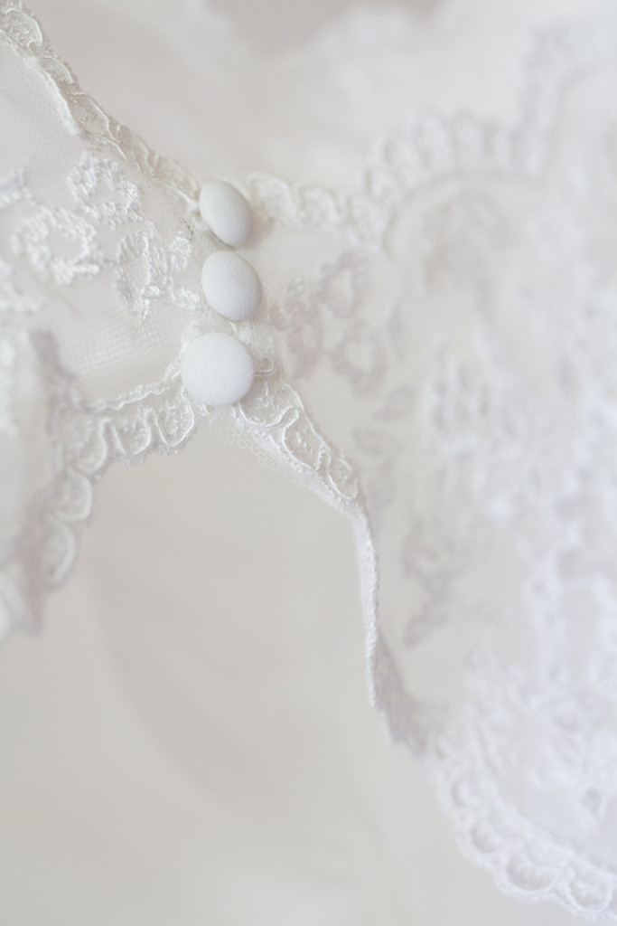 Detail image of a white wedding dress
