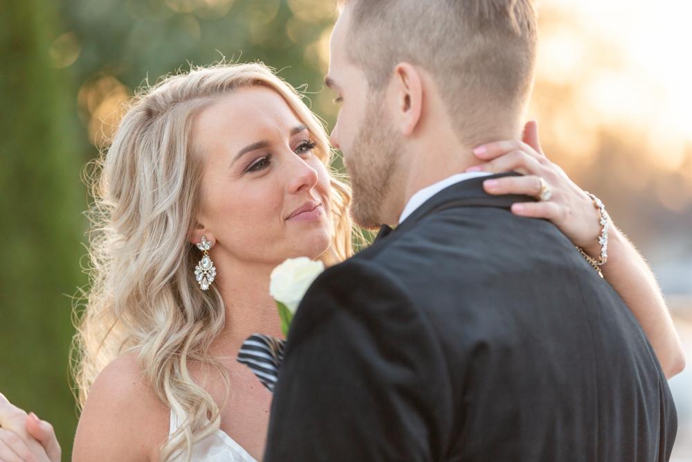 Blonde bride smiling at her groom