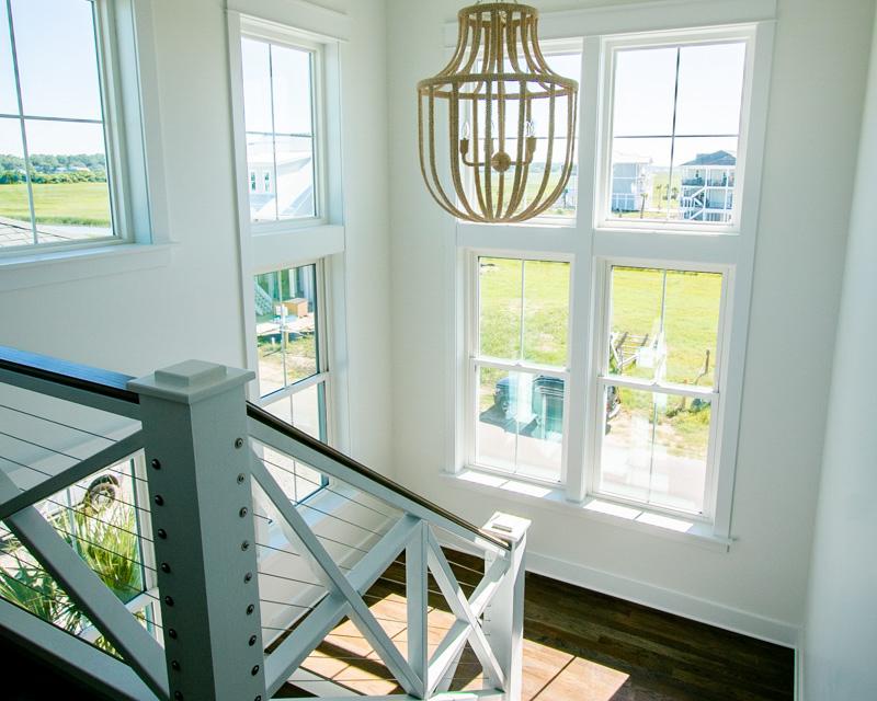 modern stairway by custom home builder