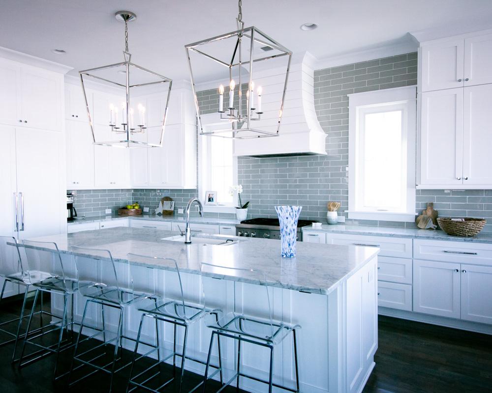 modern white kitchen by ocean isle home builder