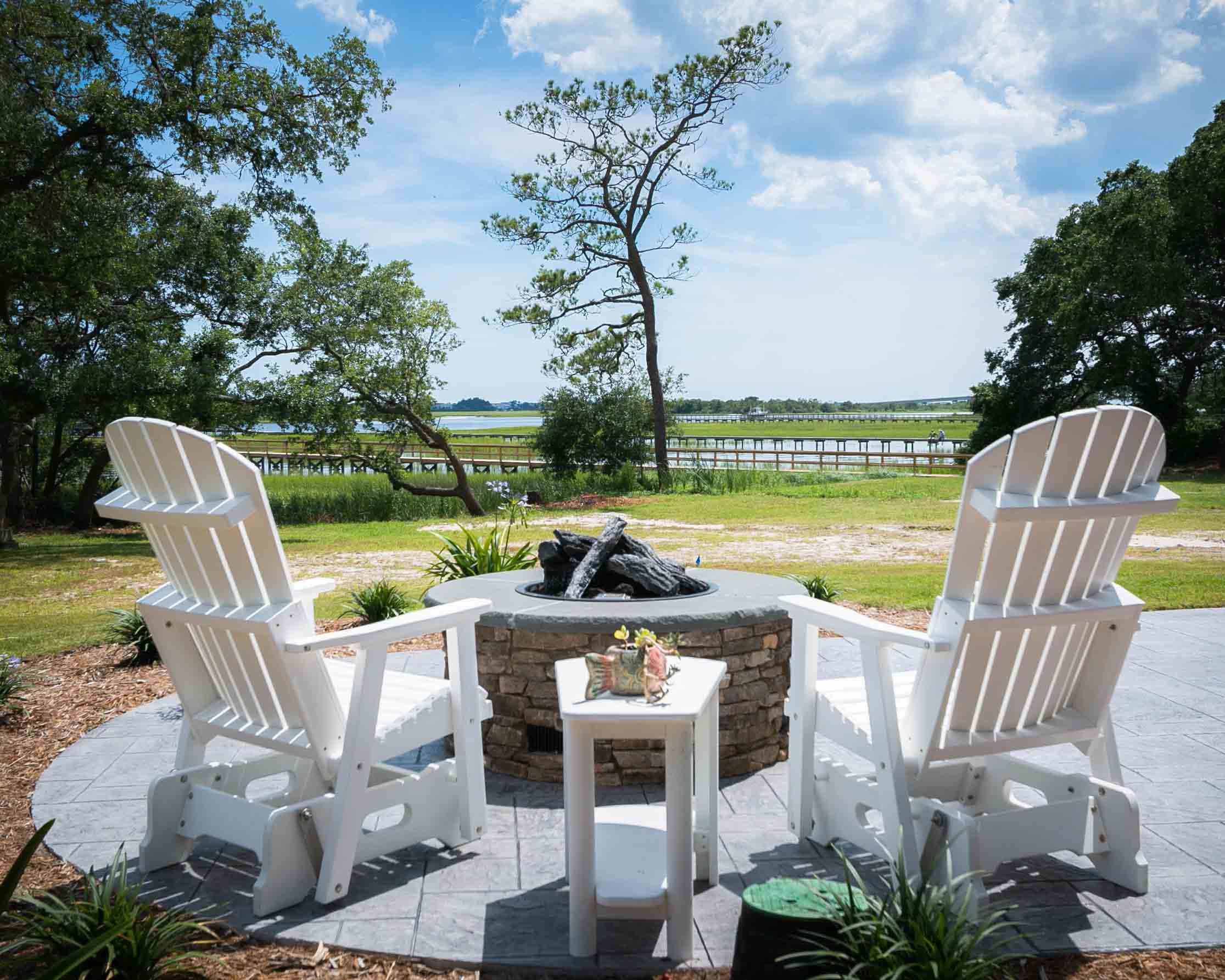outdoor fireplace by custom ocean isle home builder