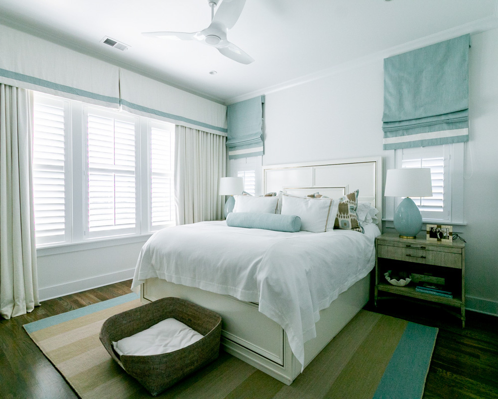 airy bedroom by ocean isle home builder