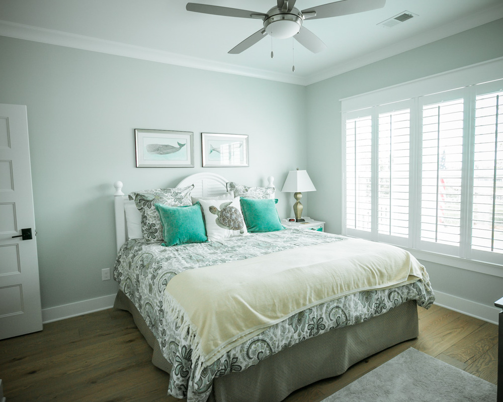 bright bedroom by sunset beach nc home builder