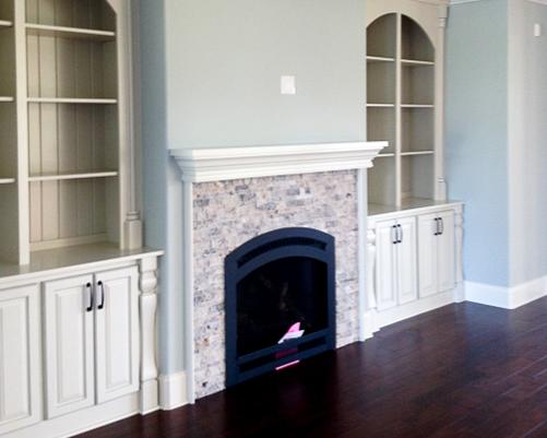 stone fireplace by custom home builder in ocean isle