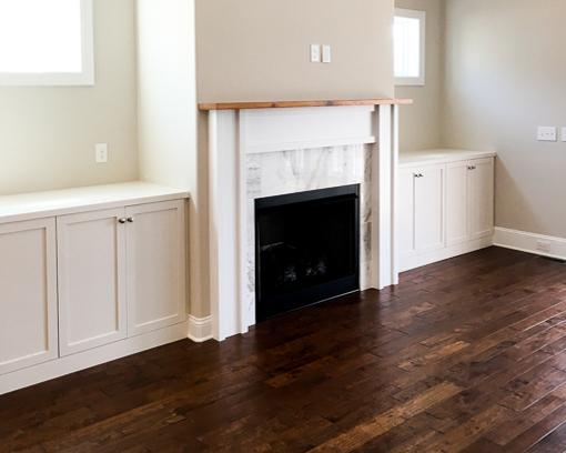 marble fireplace by custom home builder in ocean isle