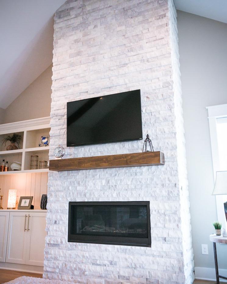 stone fireplace by custom sunset beach home builder