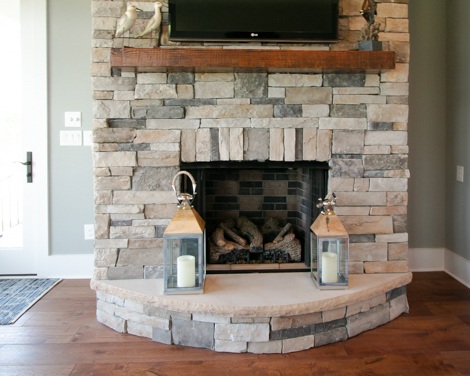 stone fireplace in new golf course home