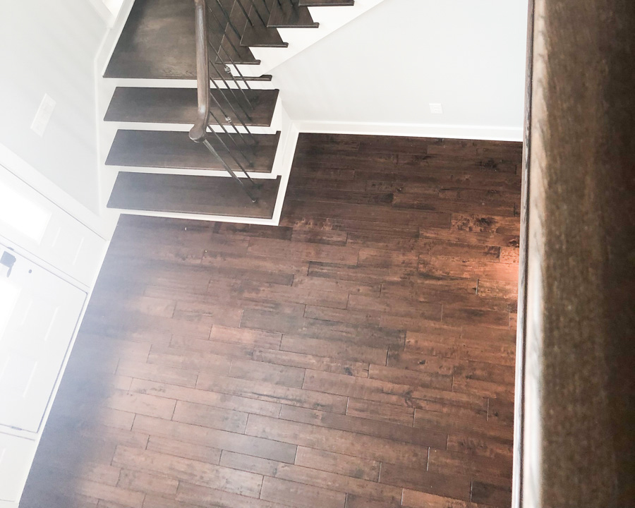 modern staircase by luxury golf course home builder