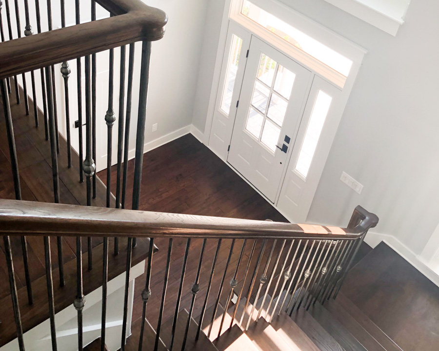 modern staircase in new golf course home