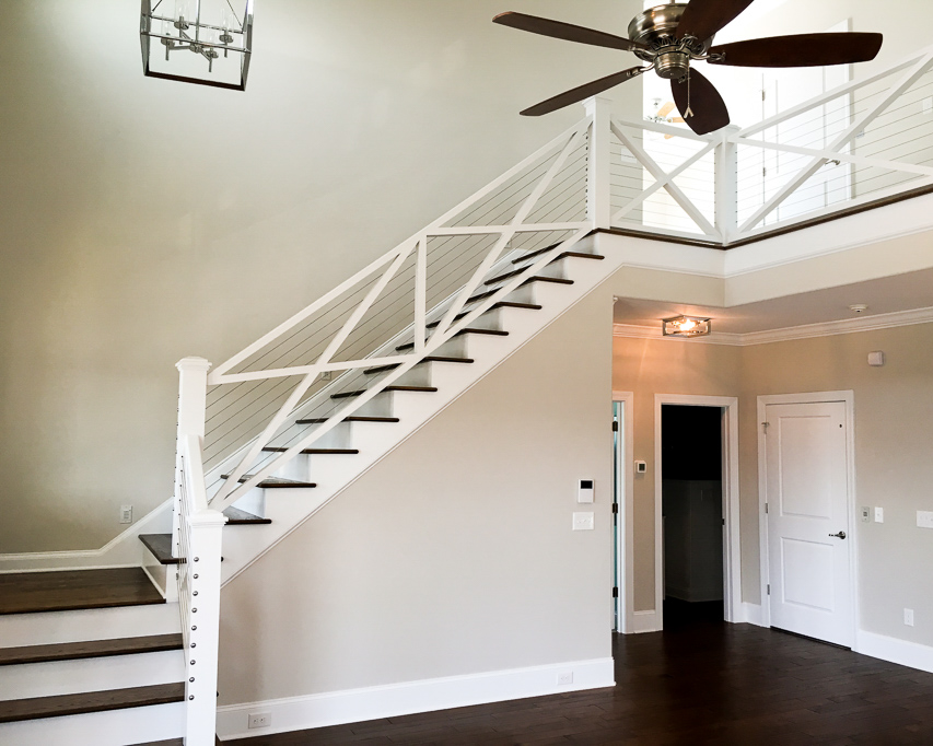 transitional stairway in custom built home