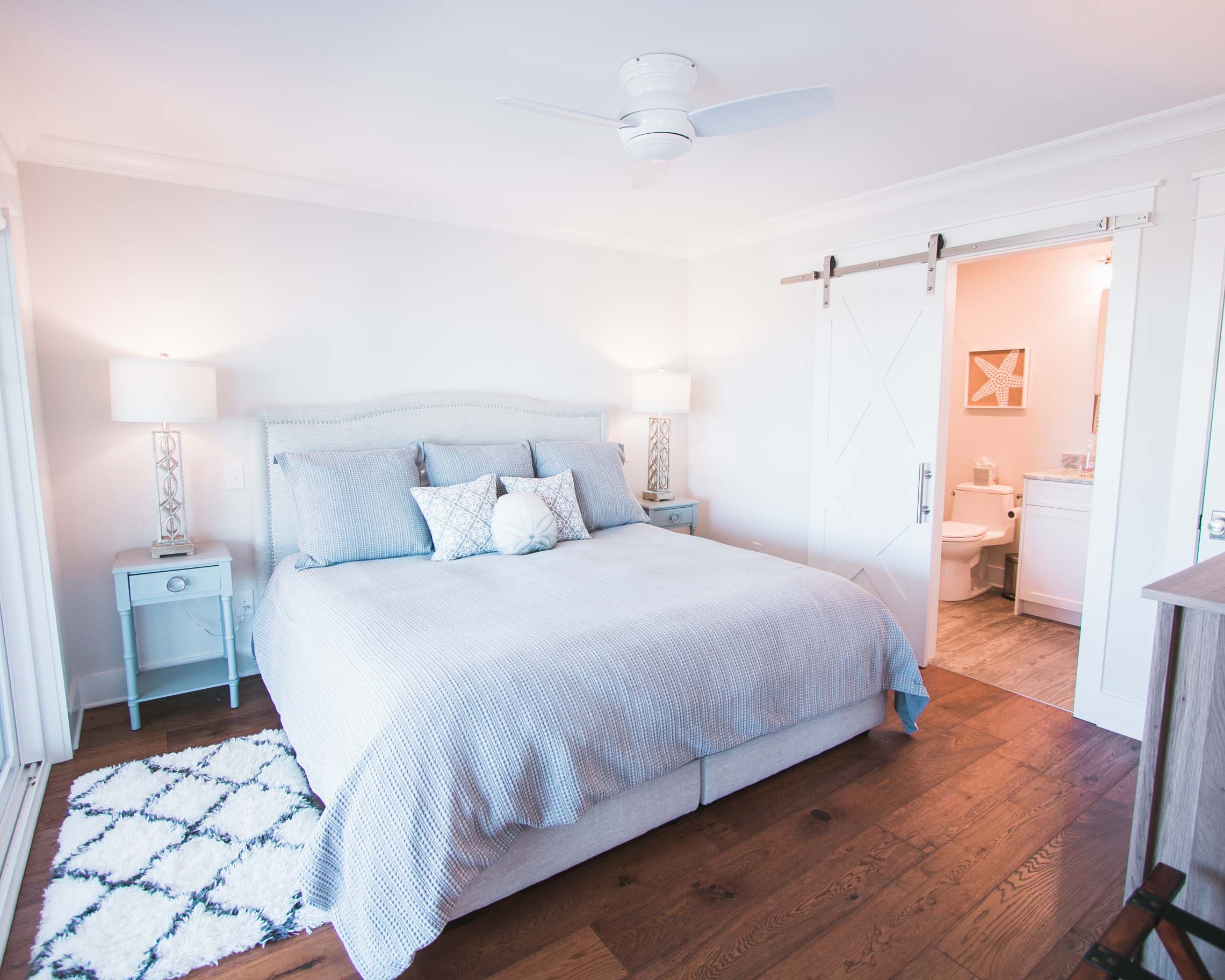 airy bedroom by ocean isle nc home builder