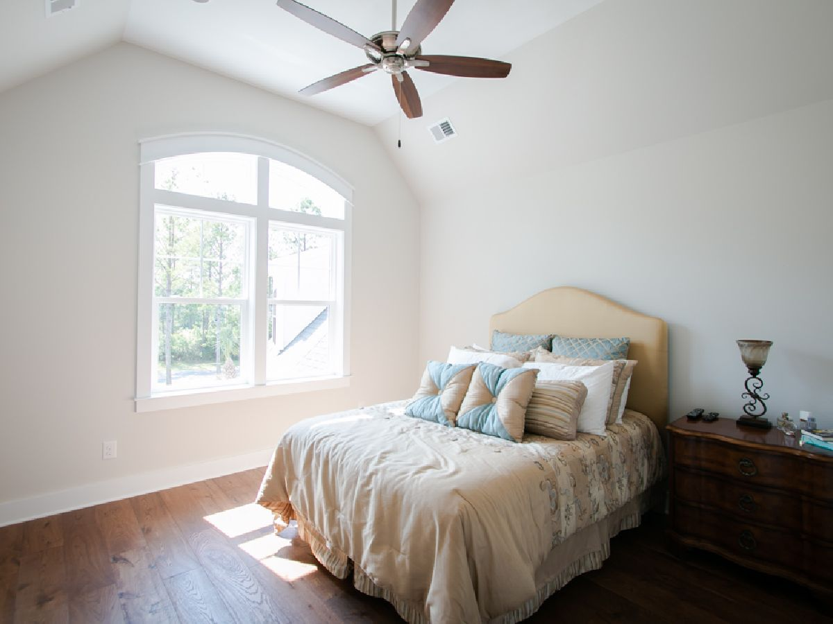 wood floor bedroom in Ocean Ridge home