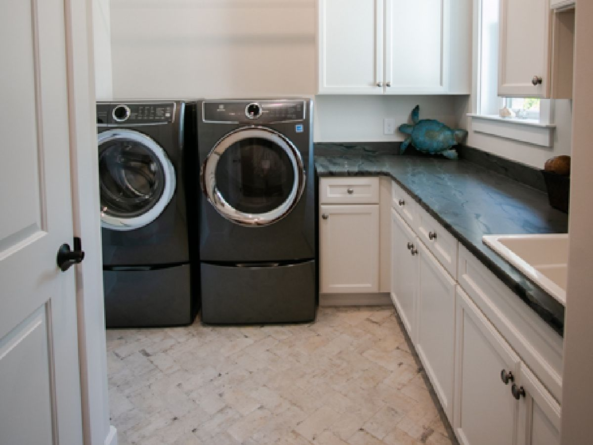 spacious laundry room in custom ocean isle new home