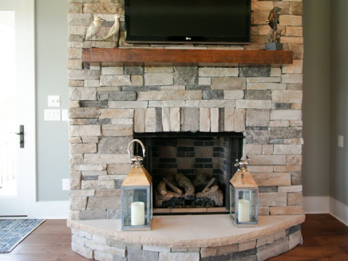 outdoor stone fireplace in custom built home