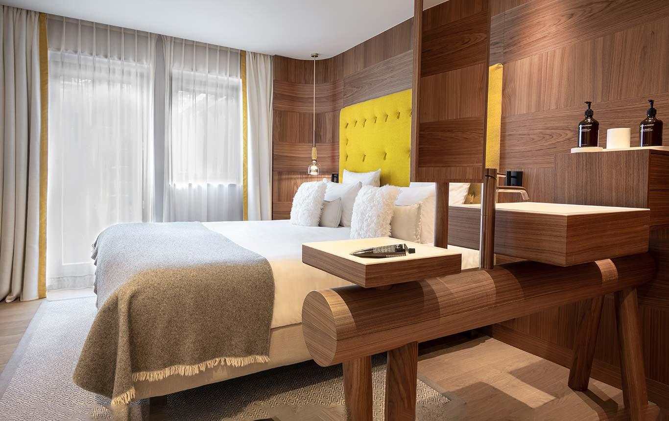 Superior Room - Open bathroom with log washbasin, aniseed headboard, balcony overlooking the village