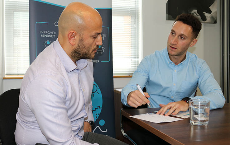 Oli with client, one-to-one surgery