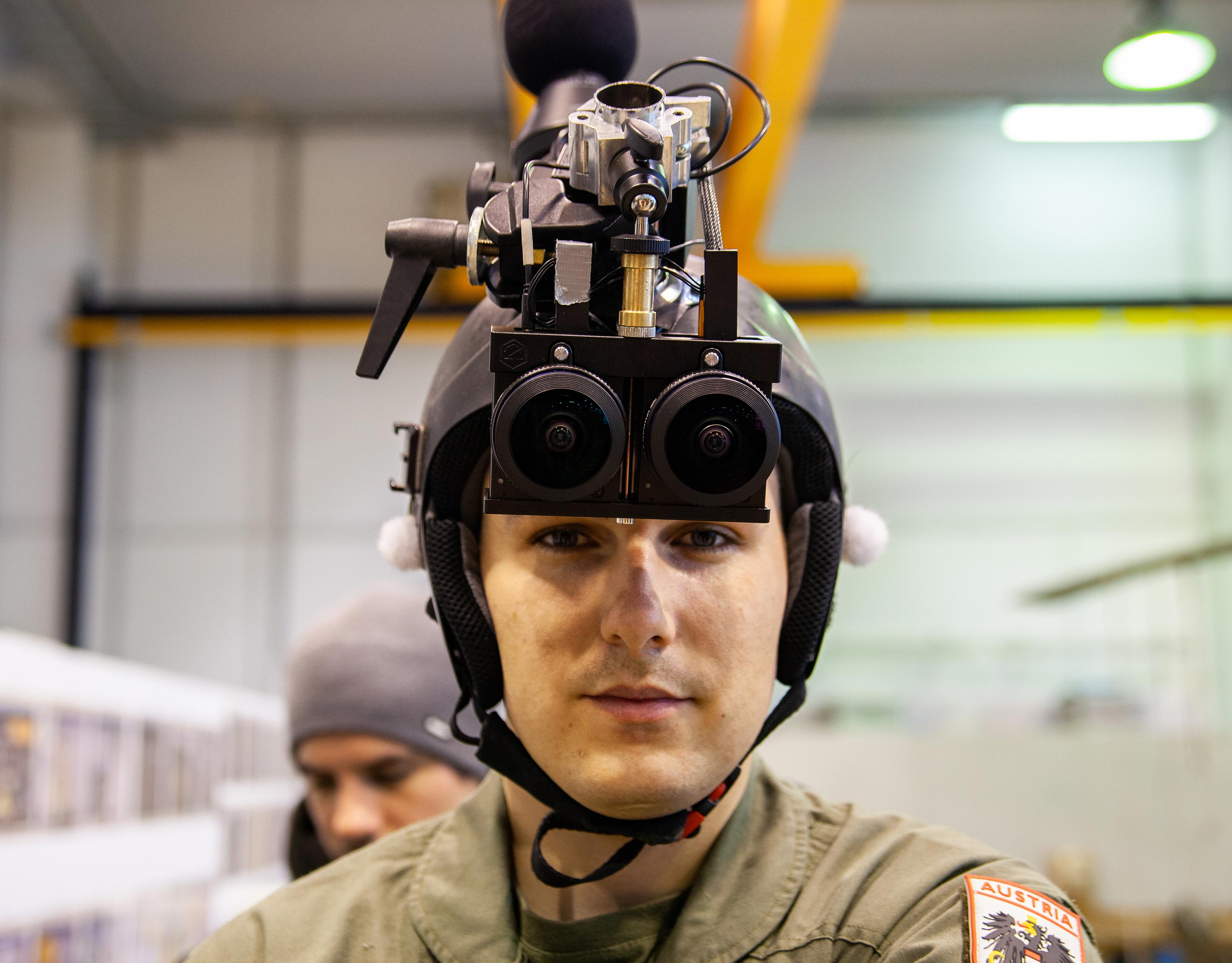 Military soldier wearing a custom 360 video rig mounted on a helmet