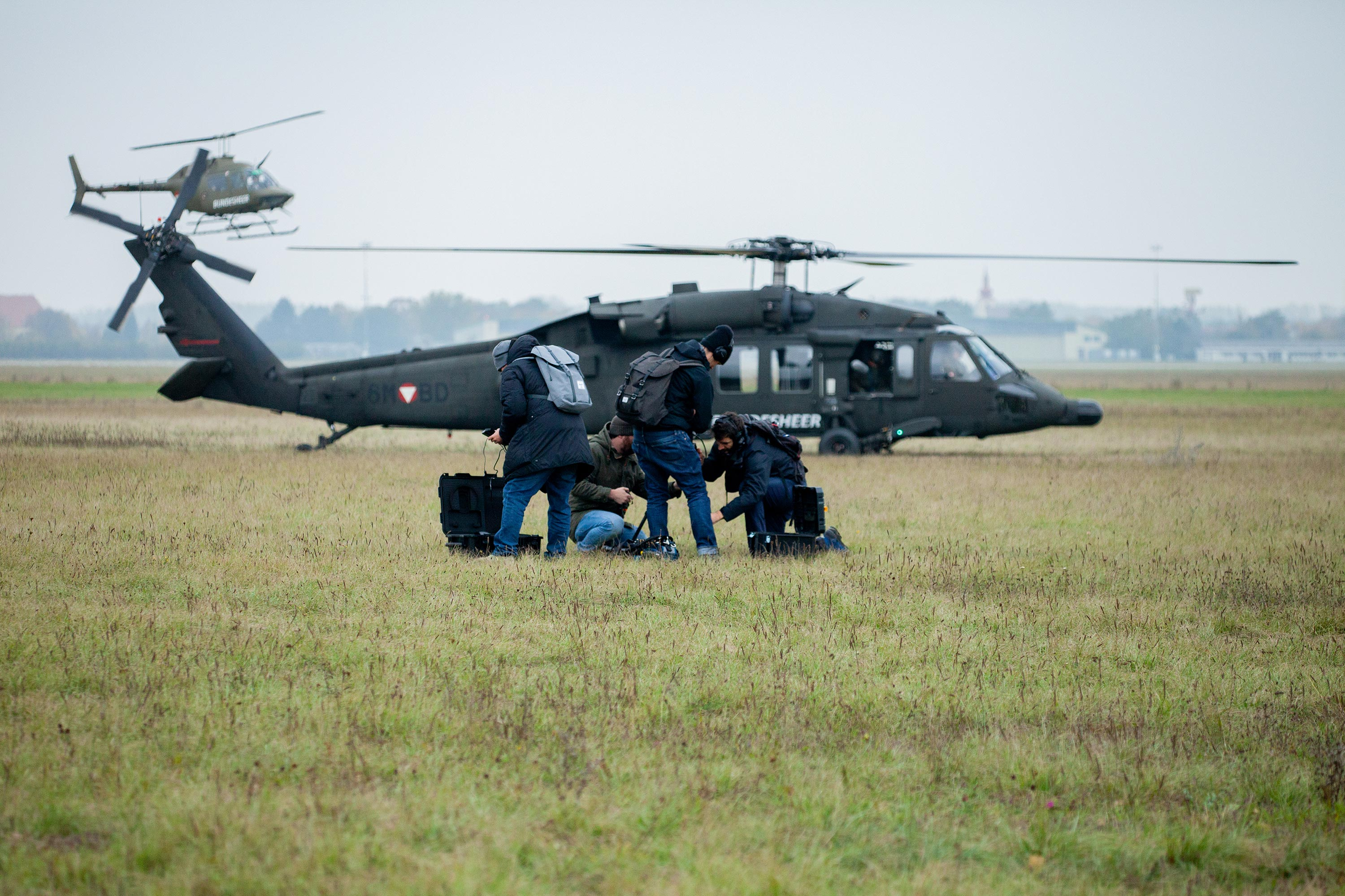 Our film crew in front of two Black Hawk helicopters during a 360 video production