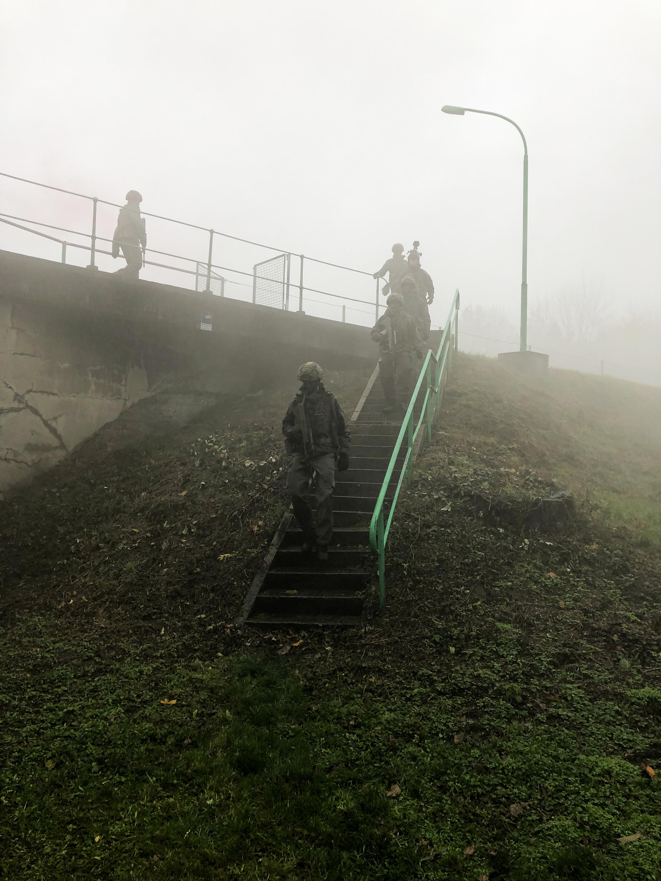 Foggy scene with soldiers running downstairs during a 360 video production