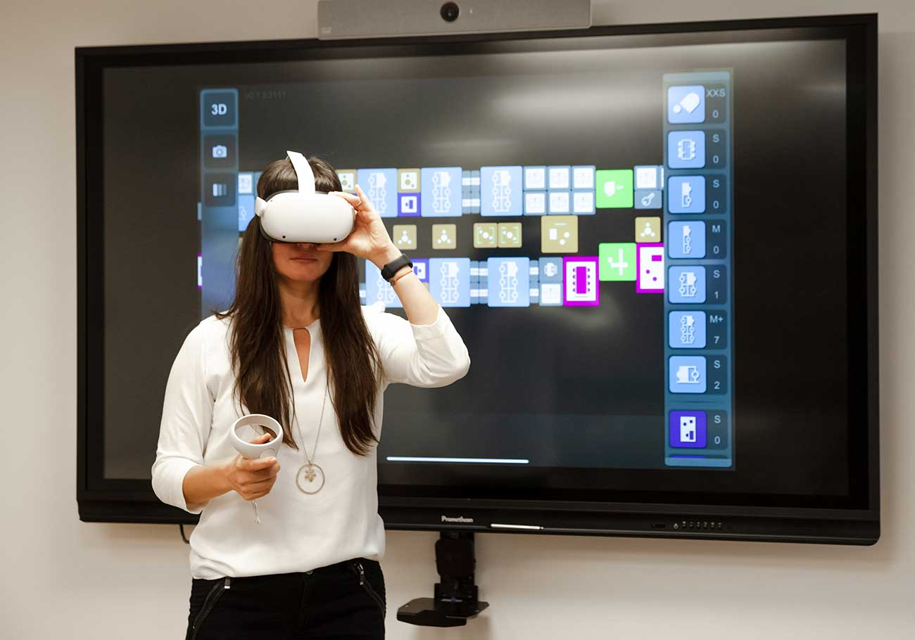 woman in front of a TV screen using a virtual reality headset