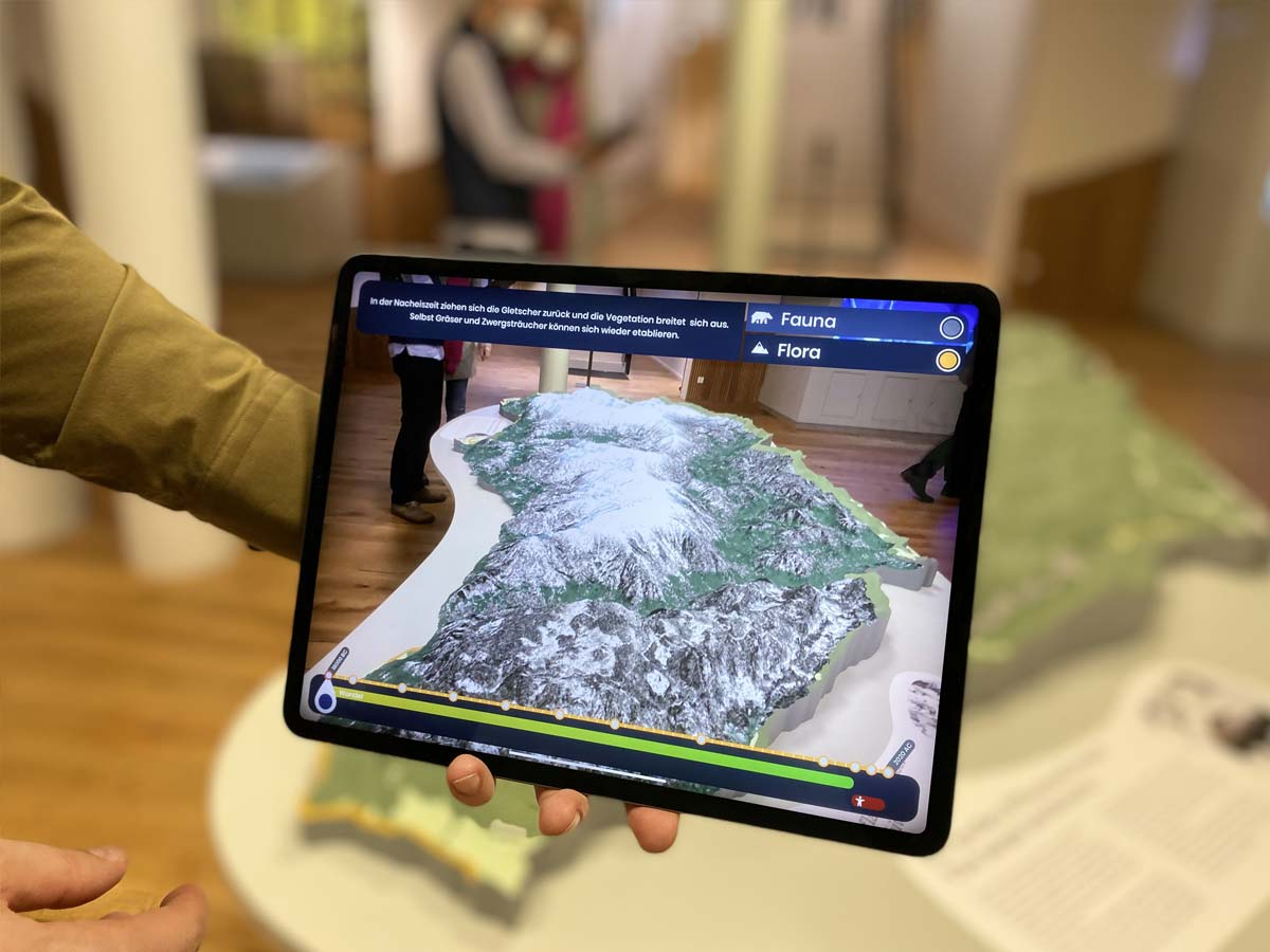 Man holding an iPad with an AR experience in it