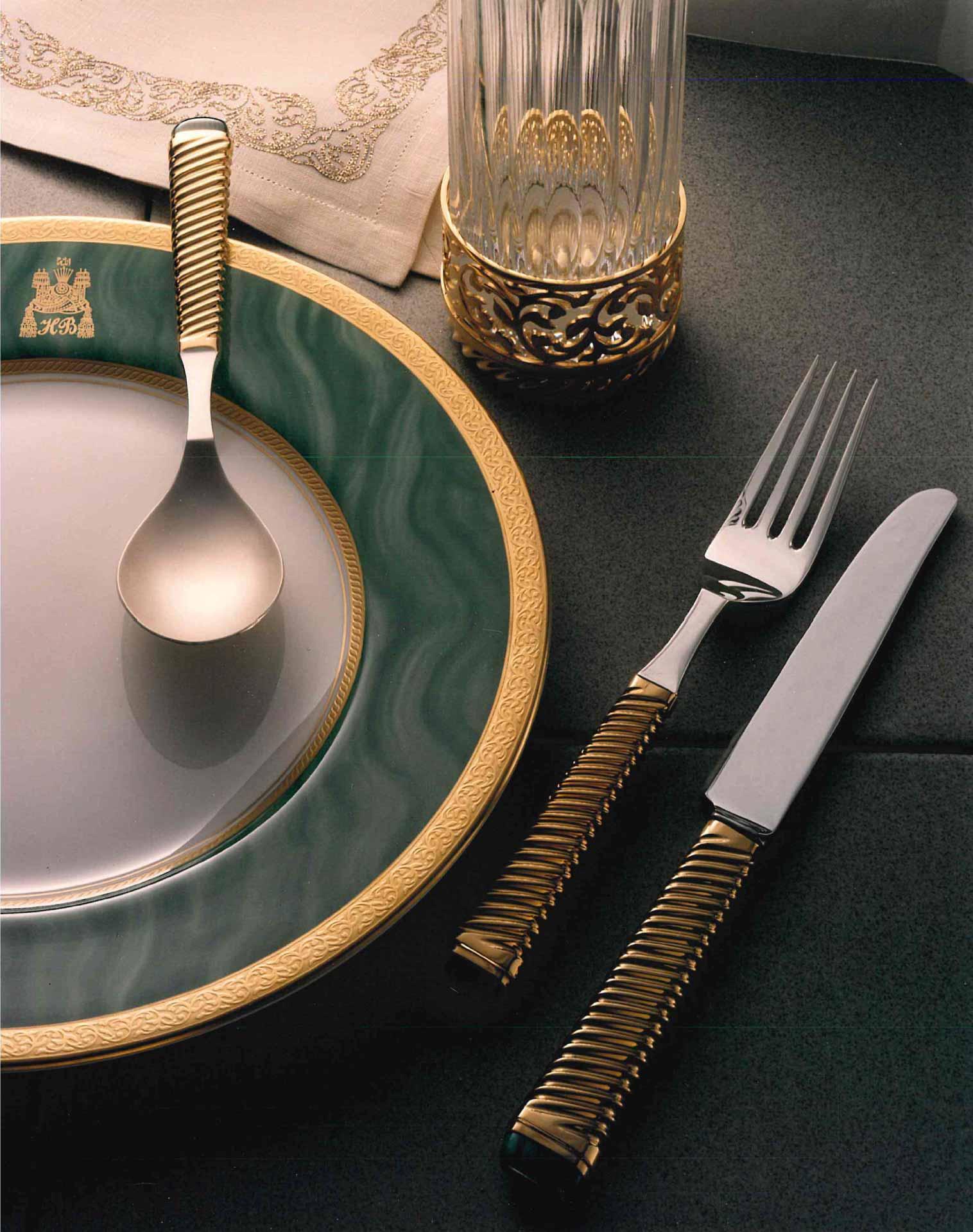 A bespoke gold-trimmed dining set designed by Dahlgren Duck