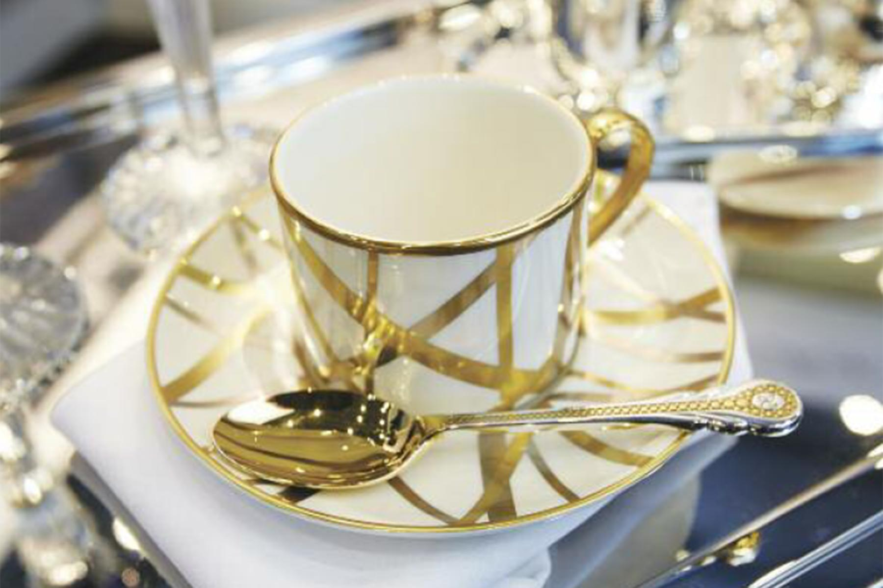A custom tea set with gold lace and gold spoon