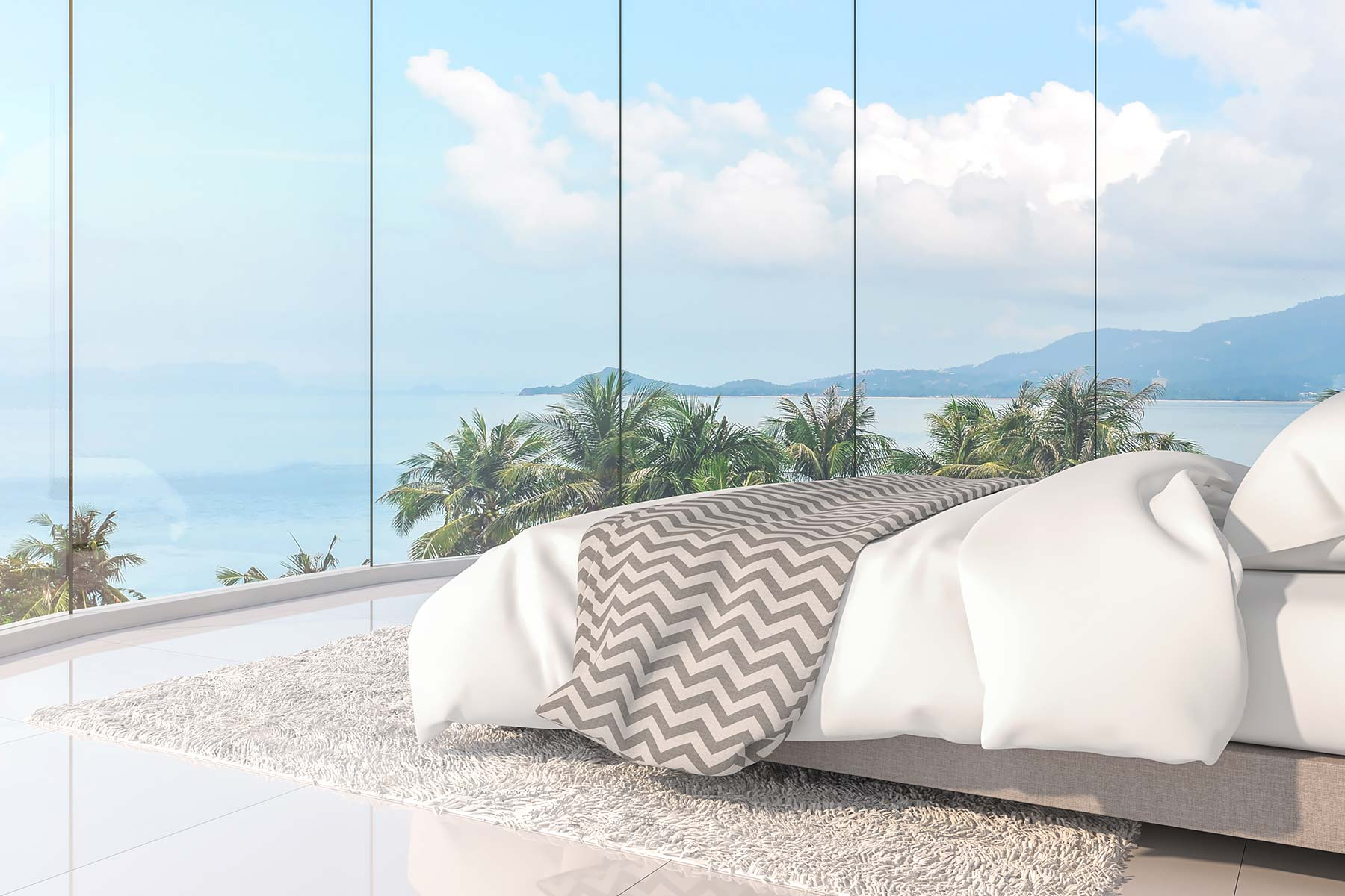A scenic view from a well-appointed bedroom overlooking the ocean