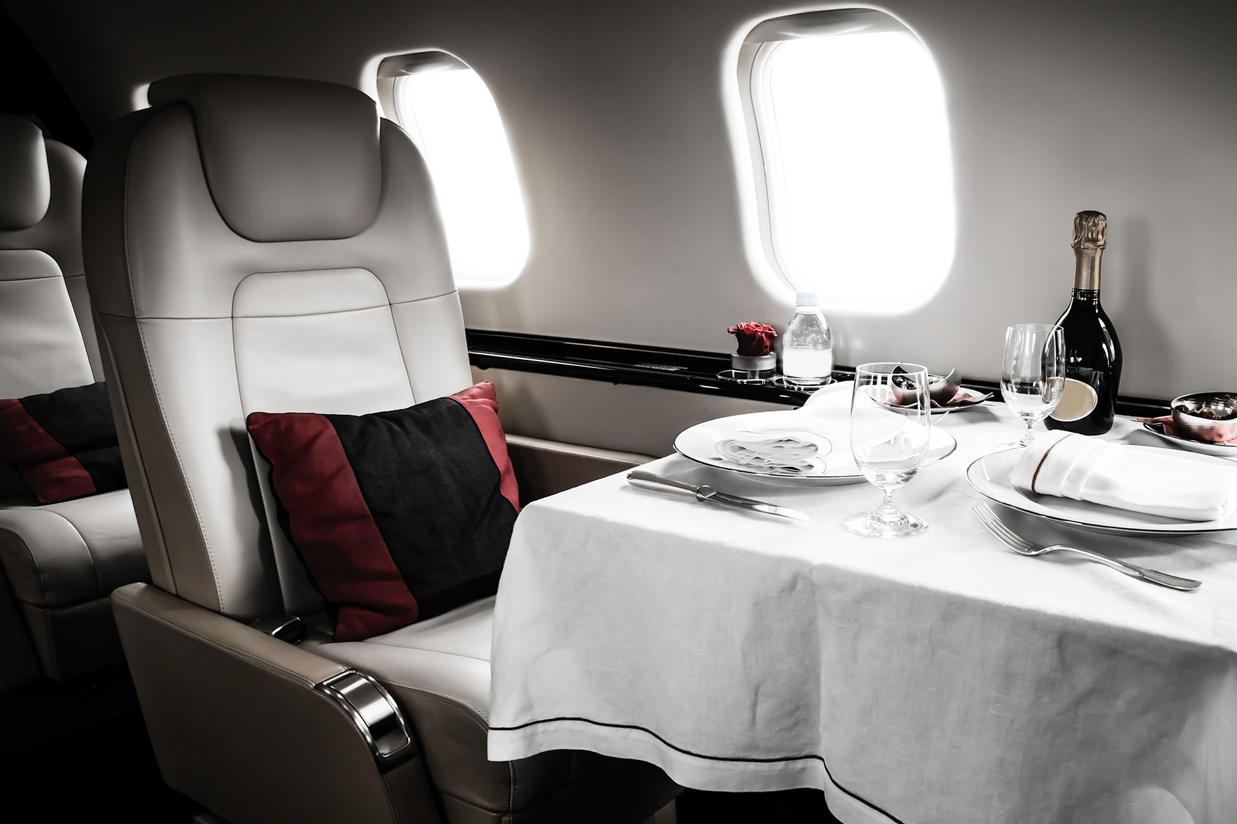 A finely appointed dinner service aboard a Gulfstream private jet aircraft