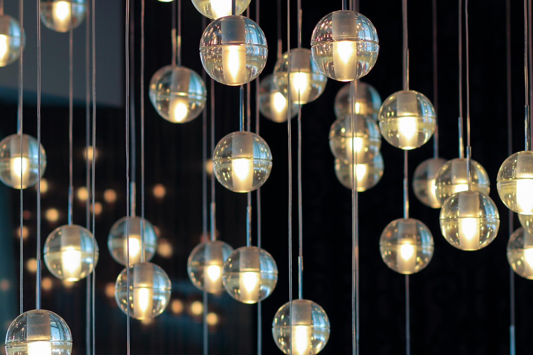 bespoke lighting fixture hangs from the ceiling