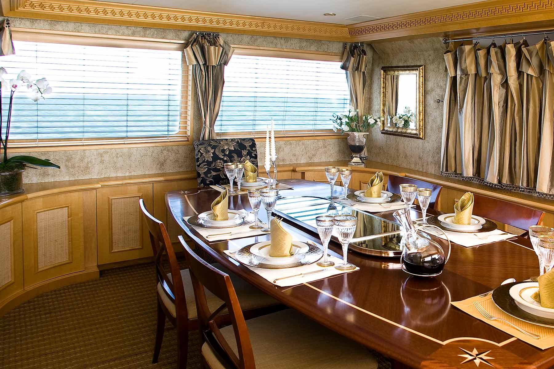 The fine dining area of a private super yacht