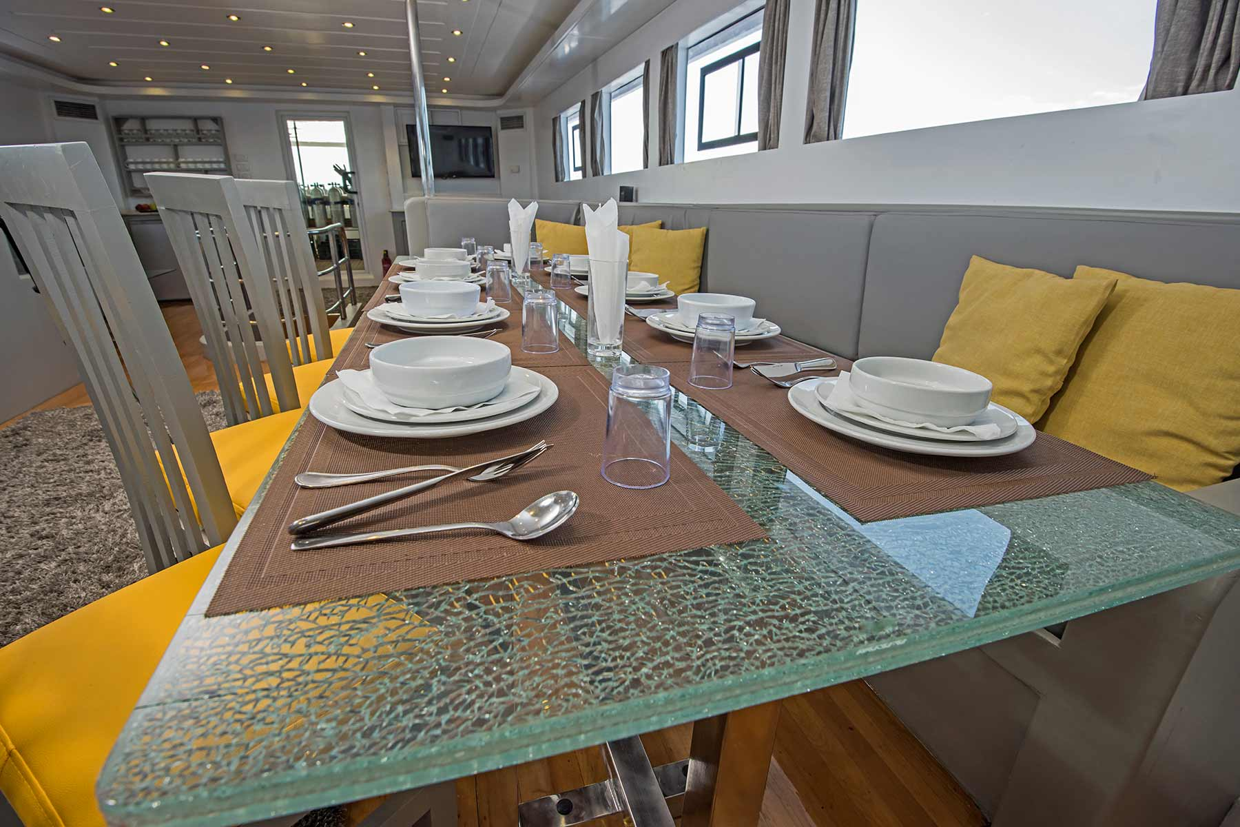 A modern bespoke dining set china crystal silverware for a custom super yacht build