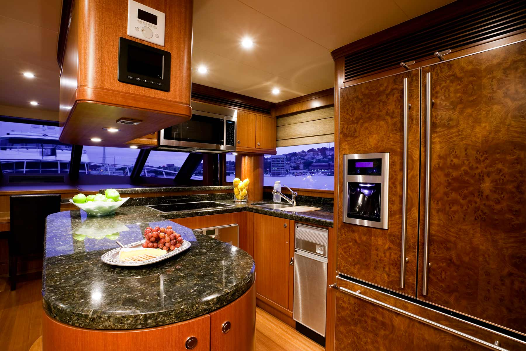 A brilliant granite kitchen aboard a private mega yacht sea vessel