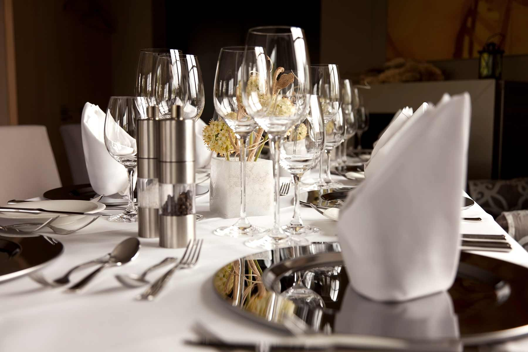 white linen table dressing and bespoke dining service for restaurant
