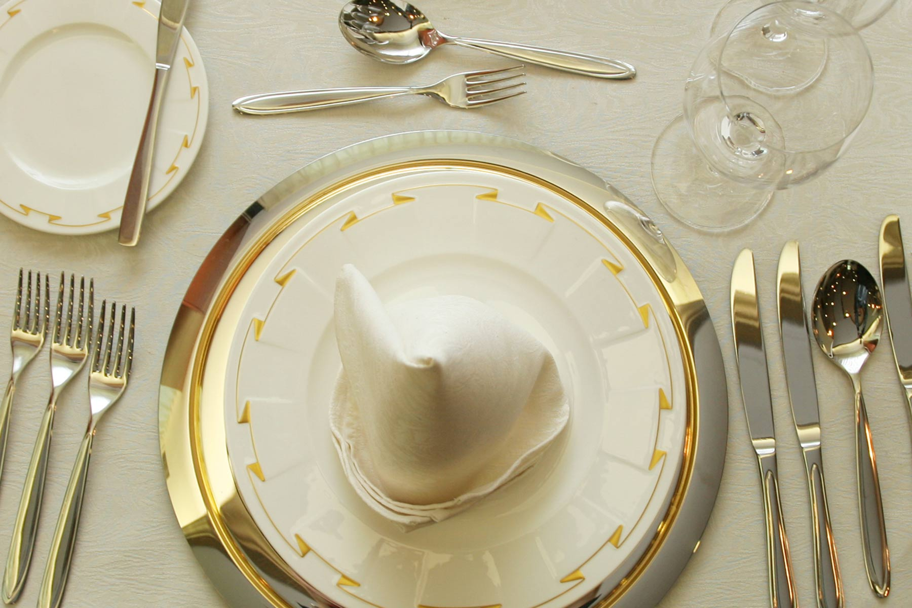 An elegant five star restaurant dinner service cutlery china crystal