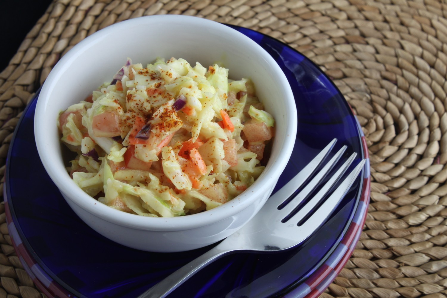 TaterSweet Coleslaw in White Bowl on Blue Plate
