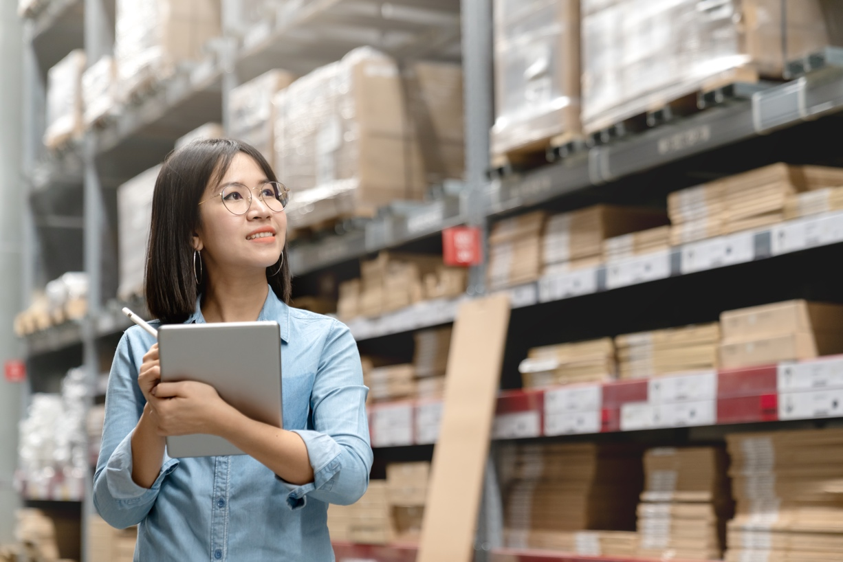 Woman using optimized warehouse inventory solution SparesCNX