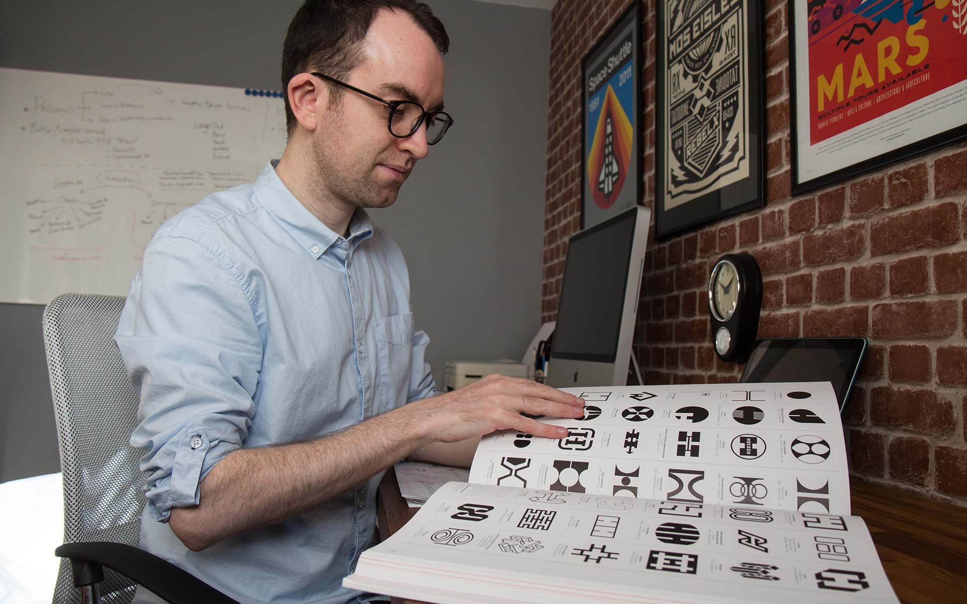 Ian Paget looking at identity design inspiration