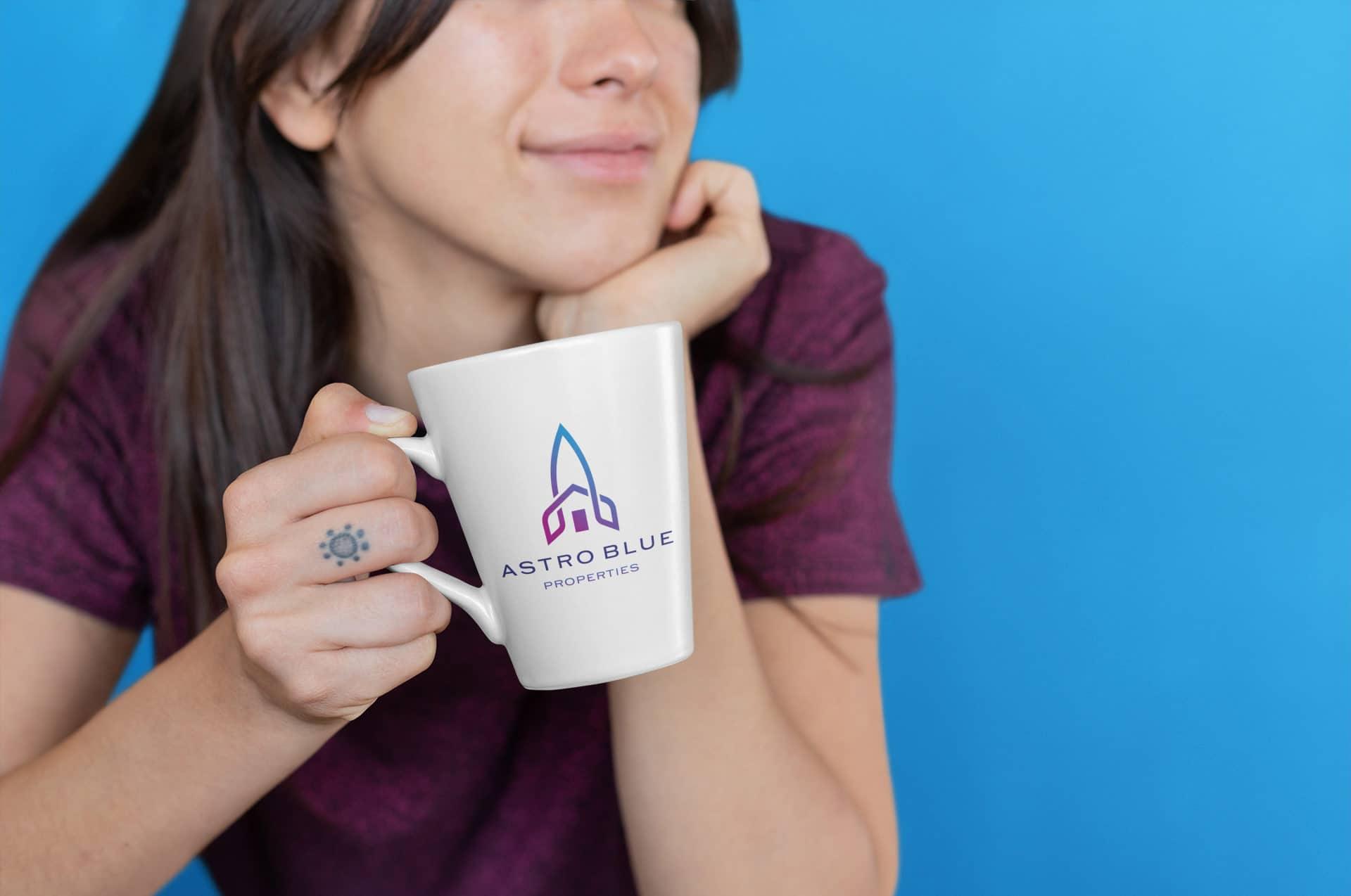 Astro Blue Properties logo on a mug
