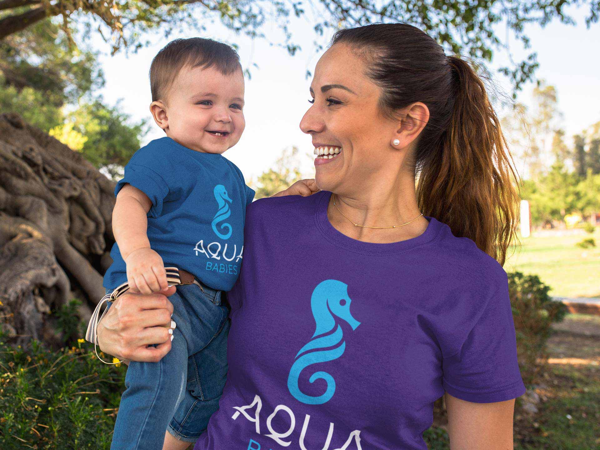Parent and child with Aqua Babies logo redesign on tshirts