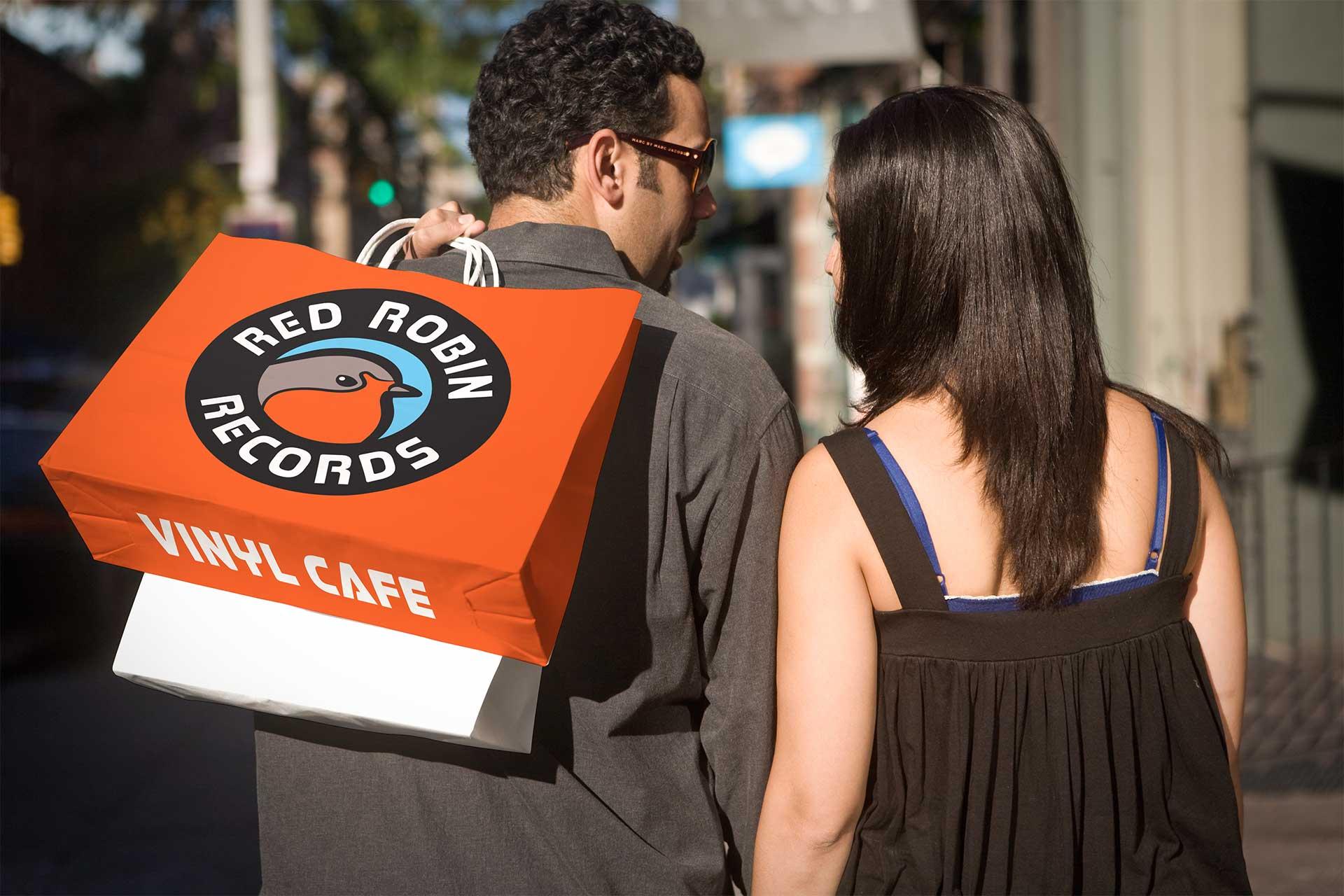 Logo Design for Vinyl Cafe, Red Robin Records presented on a bag.