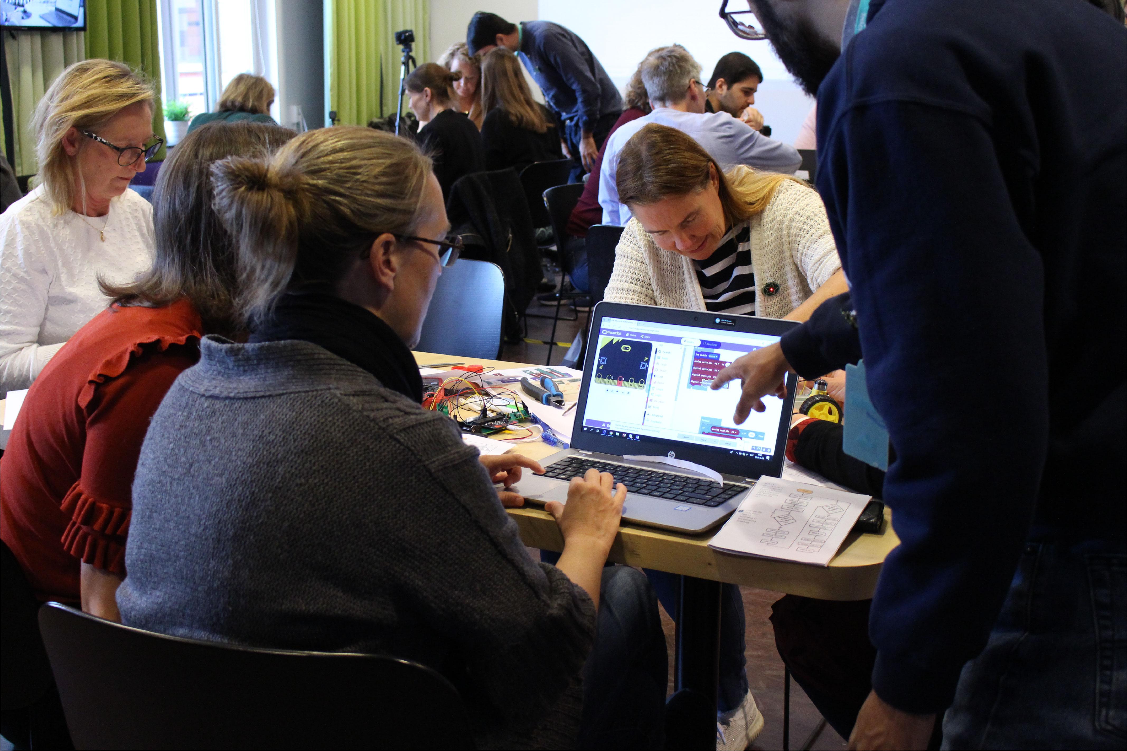 Several teachers participating at a teacher training workshop