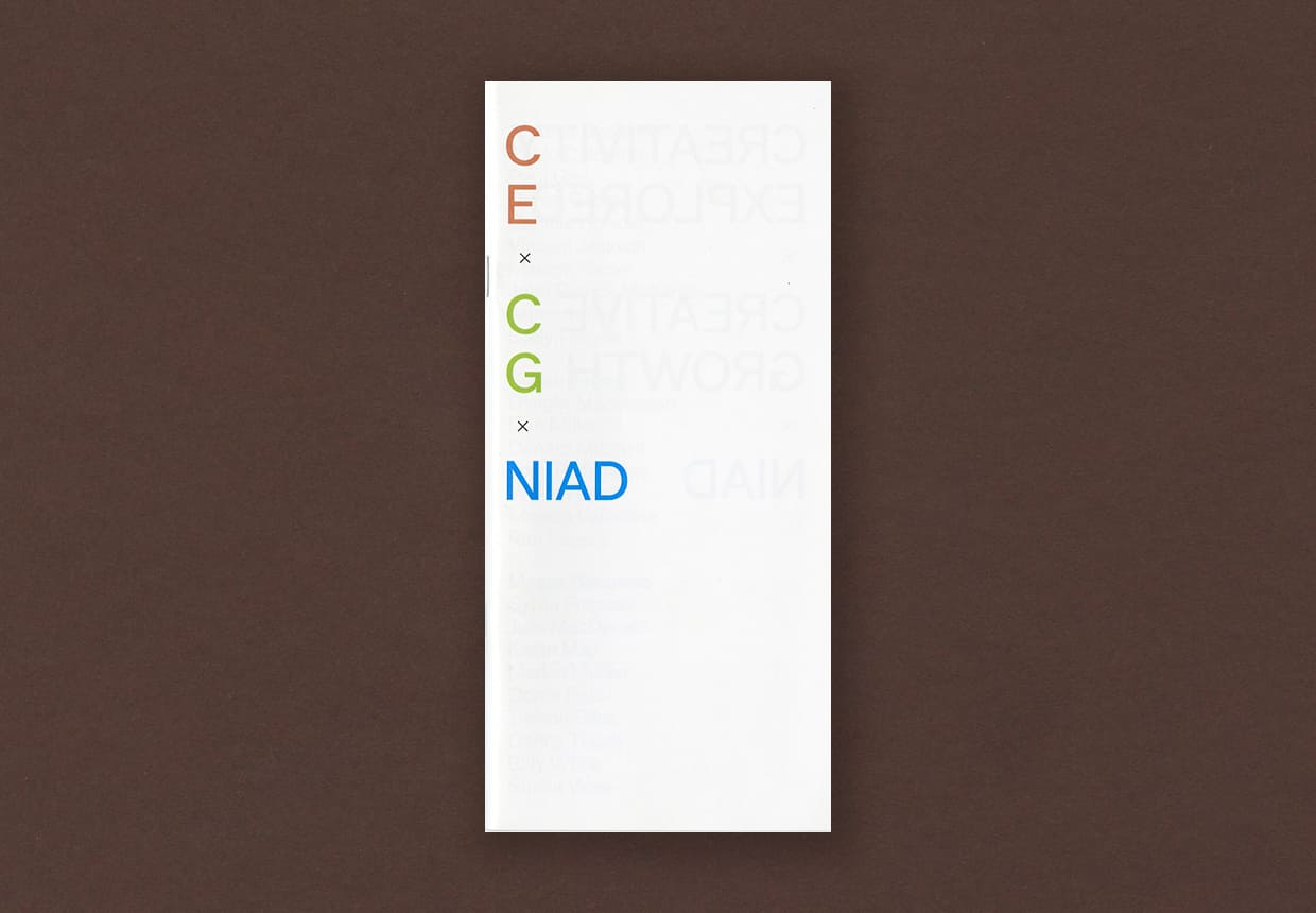 A white cover to a tall and narrow exhibition catalog for a show at Minnesota Street Projects.  Orange, green, and blue letters are stacked vertically along the left edge, all acronyms for the organizations involved in the exhibition.